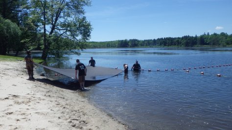 The mats were assembled on land, and then the water quality unit placed them in the water