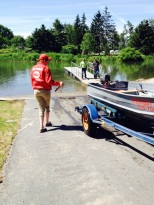 A Parks Boat Steward conducting a watercraft inspection at Keewaydin State Park. Photo by Megan Phillips, OPRHP.