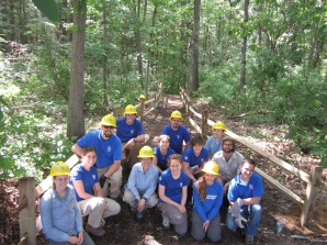 SCA Hudson Valley AmeriCorps members are all smiles after completing a new section of trail including split rail fencing at Saratoga Spa State Park.