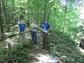 SCA Hudson Valley AmeriCorps members working to replace interpretive signage along the trail at Esopus Meadows Preserve.