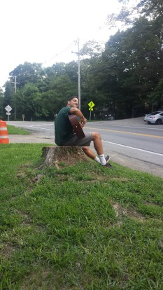 Mike Orellana playing guitar on a slow day, photo by Katie Tarsiewicz