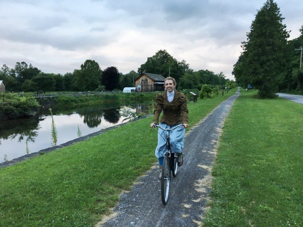 Author Kjirsten Gustavson on her 1963 Raleigh bicycle at the Erie Canal Boat Landing Museum lighter