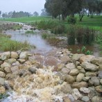 Constructing river rock dams to control water flow