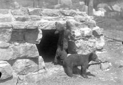 Soot and Smoke near their bear cave, photo courtesy of Allegany State Park Historical Society.